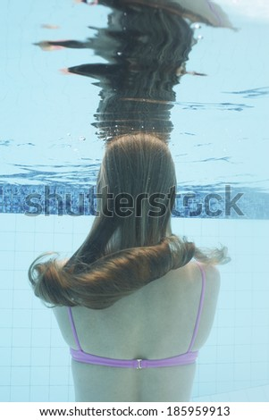 Mid adult woman diving (underwater view)