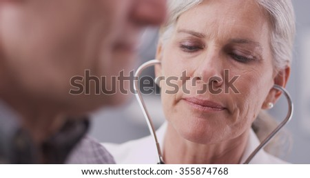 Mid-aged doctor talking to male patient