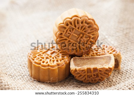 Mid-Autumn Festival moon cake on burlap background - stock photo