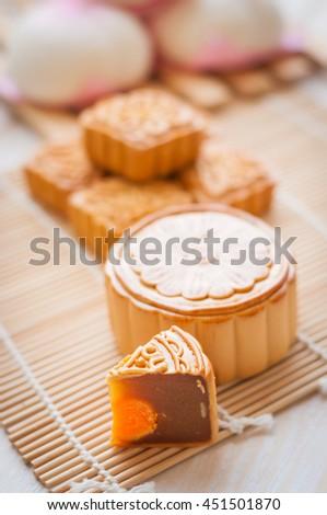 Mid-Autumn Festival moon cake on wooden board - stock photo