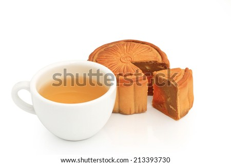 Mid-Autumn Festival moon cake with nuts and yolk inside and hot tea - china dessert sweet food isolated on white background. This has clipping path. - stock photo