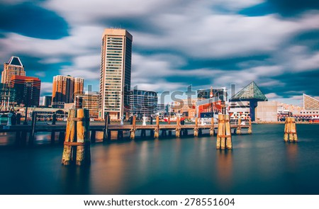 Mid-day long exposure of the Baltimore Inner Harbor Skyline - stock photo