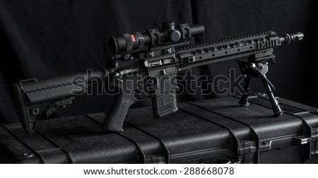 mid length rifle on rifle case - stock photo