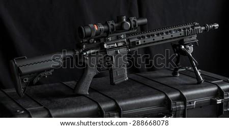 mid length rifle on rifle case - stock photo