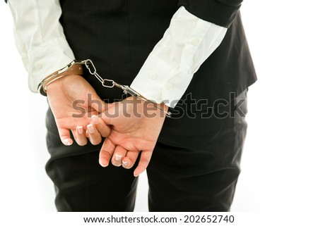 Mid section of a Asian young businesswoman dressed up as an angel handcuffs isolated on white background - stock photo
