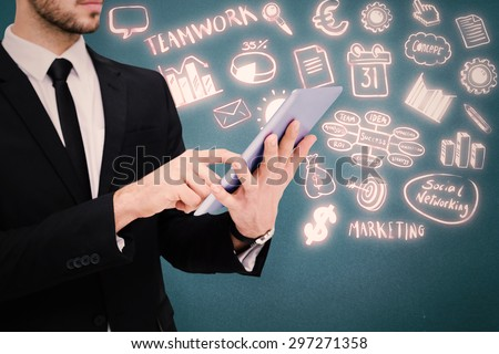 Mid section of a businessman using digital tablet pc against blue background - stock photo