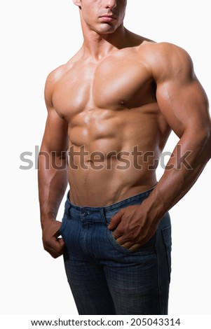 Mid section of a shirtless muscular man over white background - stock photo