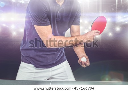 Mid section of athlete man playing table tennis against american football arena - stock photo