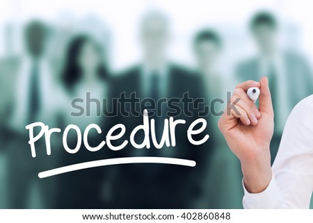 Mid section of businessman writing with marker against business team smiling and standing upright with their hands on their hips - stock photo
