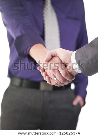 Mid section of doctors greeting each other over white background - stock photo