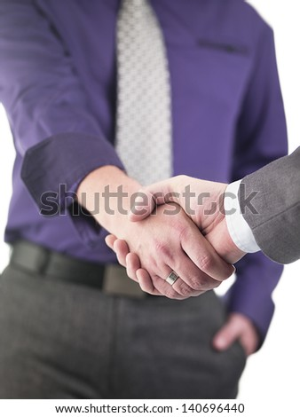 Mid section of doctors shaking hands over white background - stock photo