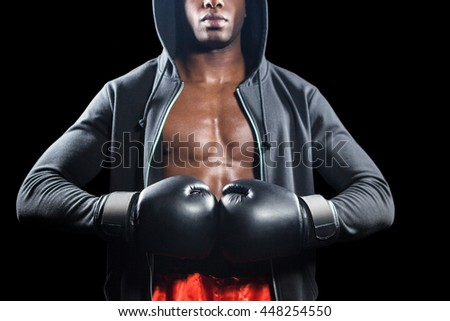 Mid section of muscular boxer on black background