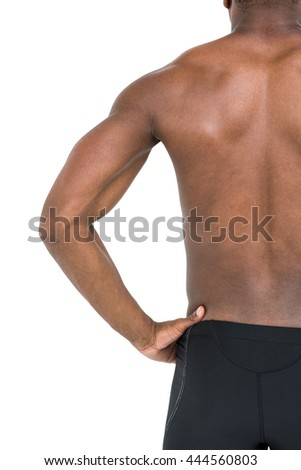 Mid-section of swimmer with hand on hip on white background