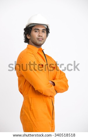 Mid shot of Indian municipal young worker on white. - stock photo
