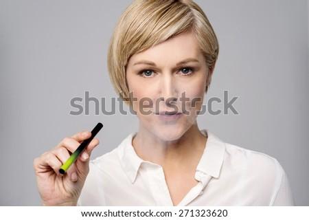Mid woman smoking modern e-cigarette - stock photo