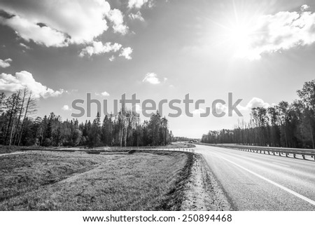 Midday sun on country roads - stock photo