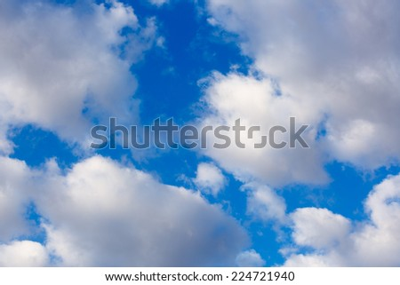 Middays clouds in blue sky - stock photo