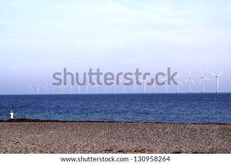 Middelgrunden which is an offshore wind farm in the Oresund 3 km outside Copenhagen - stock photo