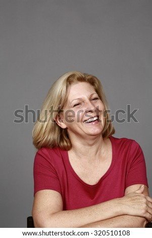 middle age blond woman with great teeth laughing