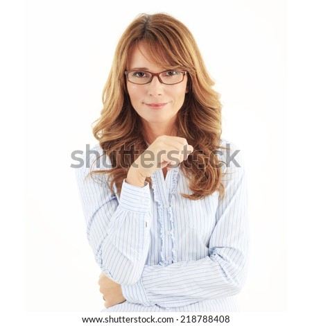 Middle age businesswoman standing against white background.  - stock photo