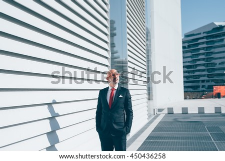 Middle-age contemporary businessman outdoor in the city overlooking pensive - thoughtful, business, thinking future concept - stock photo