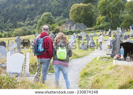 Middle age couple at the cemetery in Glendalough, Wicklow mountain, Ireland