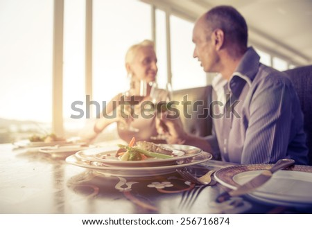middle age  couple having lunch and drinking red wine - stock photo