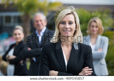 middle age female manager and her team