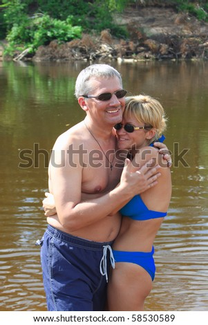 Middle age man and woman couple together - stock photo