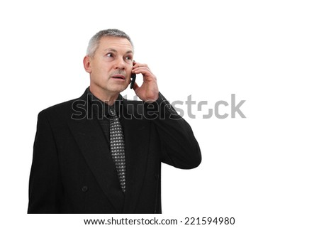 Middle age man in business black suit calls by mobile phone isolated on white background with copy space on right with copy space - stock photo