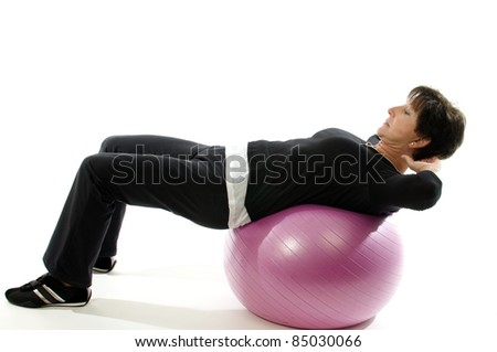 middle age senior woman fitness exercise  with core training ball for abdominal crunch sit-ups - stock photo