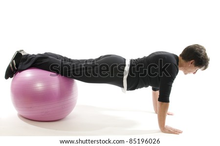 middle age senior woman fitness exercise with core training ball push ups - stock photo