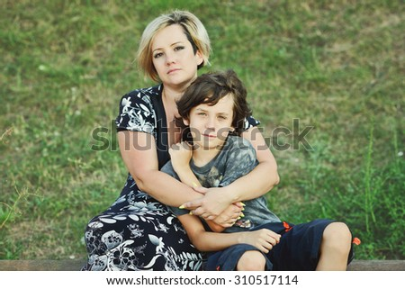 middle age woman and her son outdoors - stock photo