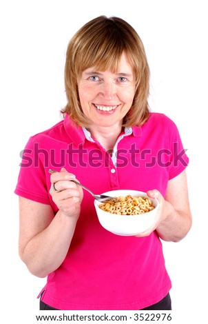 Middle Age Woman Eating Breakfast Cereal, Isolated Over A White Background