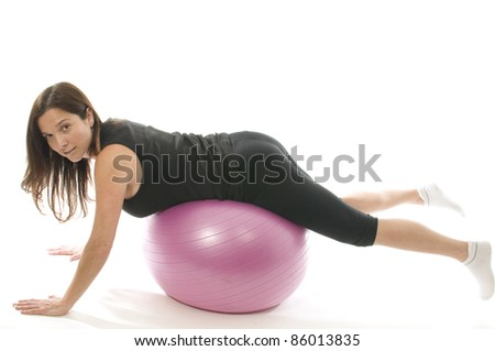 middle age woman exercising stretch push-ups on fitness core training ball