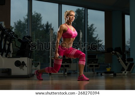 Middle Age Woman Performing Dumbbell Squats - One Of The Best Body Building Exercise For Legs - stock photo