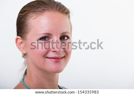 Middle age woman with a nice trustful smile looking at camera