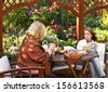 Middle age women drinking coffee in a garden outdoors. Shallow depth of field - stock photo