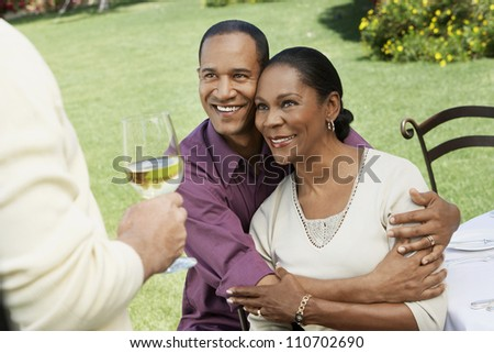 Middle aged African American man embracing his wife - stock photo