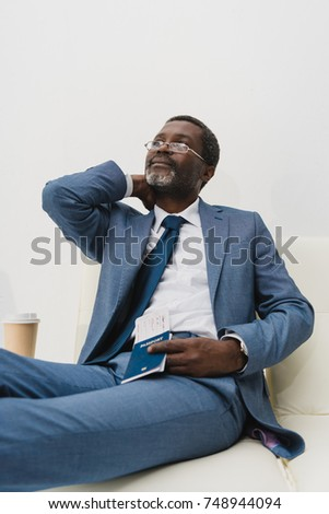 Middle aged African american man waiting at the airport