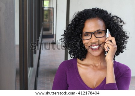 Middle-aged African woman talking on her cell phone - stock photo