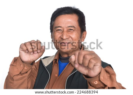 middle aged angry gesturing fist raised menacing threat studio portrait on isolated white background