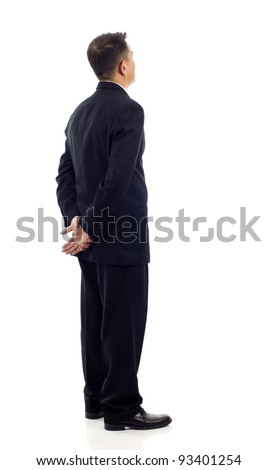 Middle aged Asian business man from the back - looking at something over a white background