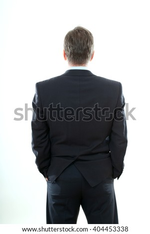 Middle aged Asian business man in suit from the back - looking at something over white background - stock photo