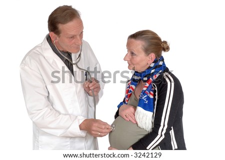 Middle aged attractive male doctor giving physical exam to pregnant female patient.  health care concept. - stock photo