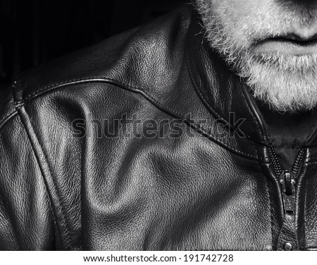 Middle-aged biker with beard and leather jacket. Motorcycle culture. - stock photo