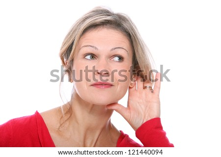 Middle aged blonde in listening gesture over a white background - stock photo