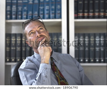 Middle aged business man in a pensive mood - stock photo