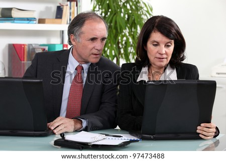 Middle-aged business partners - stock photo