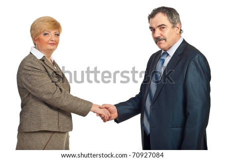 Middle aged business people shaking hands isolated on white background - stock photo